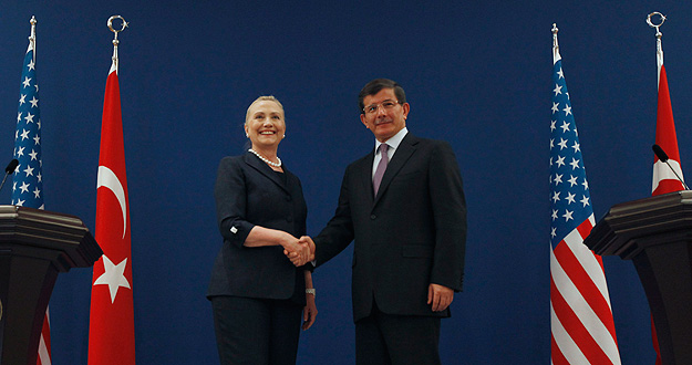 U.S. Secretary of State Clinton and Turkish Foreign Minister Davutoglu pose for the media after their news conference
