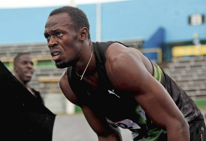 Usain Bolt durante una prueba 4X100m en Kingston.