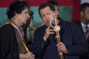 Venezuela's President Hugo Chavez presents Libya's leader Muammar Gaddafi with a replica of the sword of national hero Simon Bolivar, in Margarita Island