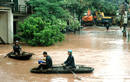 Residents row boats along flooded road in Vietnam's northern Quang Ninh province
