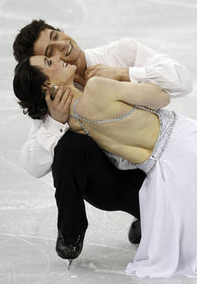 Canada's Virtue and Moir finish their performance in the ice dance free dance figure skatin