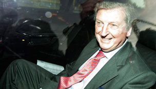 West Bromwich Albion coach Roy Hodgson smiles as he is driven from Wembley Stadium in London