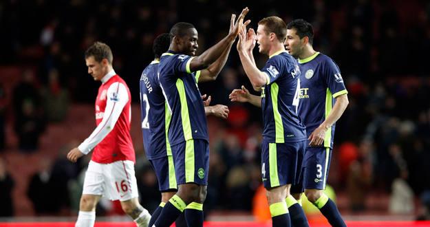 Los jugadores del Wigan celebran la victoria ante el Arsenalq ue les eprmite aferrarse a la salvación.