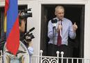 WikiLeaks founder Julian Assange gives the thumbs up sign after speaking to the media outside the Ecuador embassy in west London