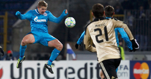 Zenit St. Petersburg's Hubocan jumps to head the ball during their Champions League last 16 first leg soccer match against Benfica at the Petrovsky stadium in St. Petersburg
