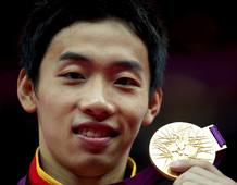 Zou Kai of China celebrates with his gold medal in the men's gymnastics floor exercise victory ceremony in the North Greenwich Arena during the London 2012 Olympic Games